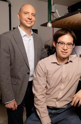 Chemical and biomolecular engineering professor Charles Schroeder, left, and graduate student Peter Zhou have found that single polymers -- acting as individuals -- work together to give synthetic materials macroscopic properties like viscosity and strength.